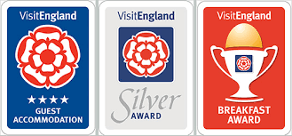 three of the awards awarded to kilbrannan guest house which are the visit england four star guest house award, the visit england breakfast award and the visit england silver award.